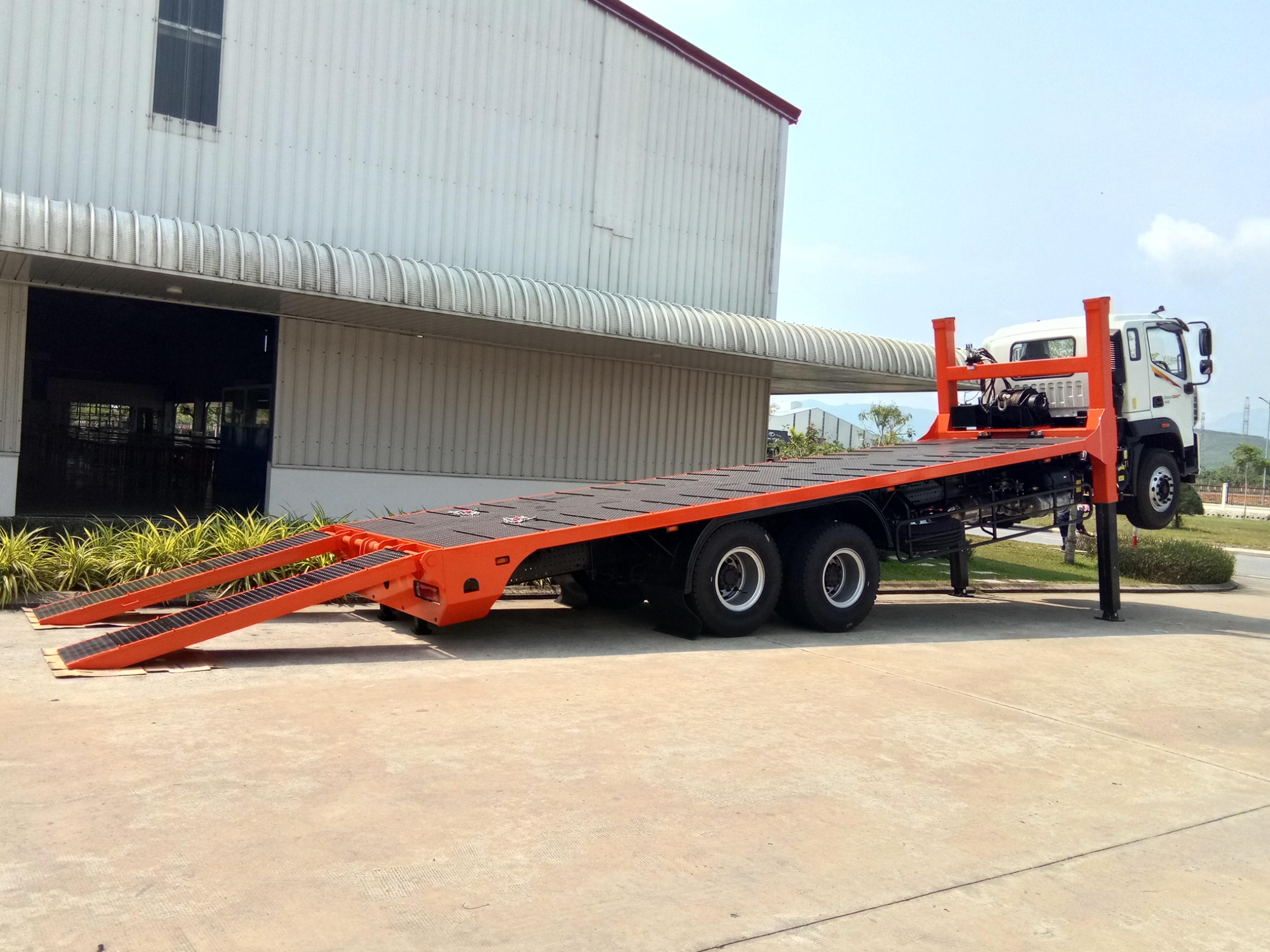 Auman C240 nâng đầu chở máy công trình 14 tấn