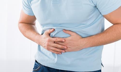 Đau tinh hoàn bên phải và đau lưng là bệnh gì